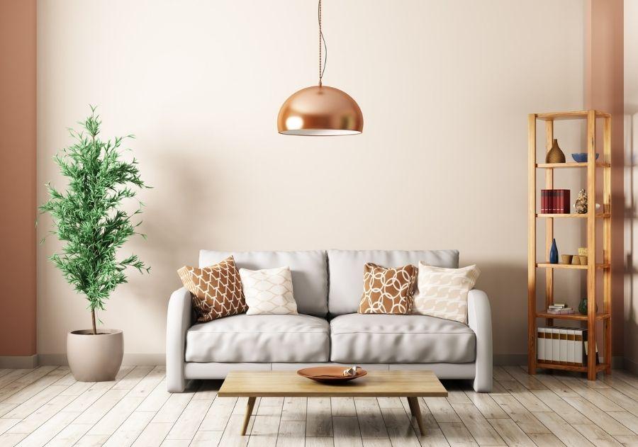 decoração com almofadas estampadas em sala escandinava com tons claros