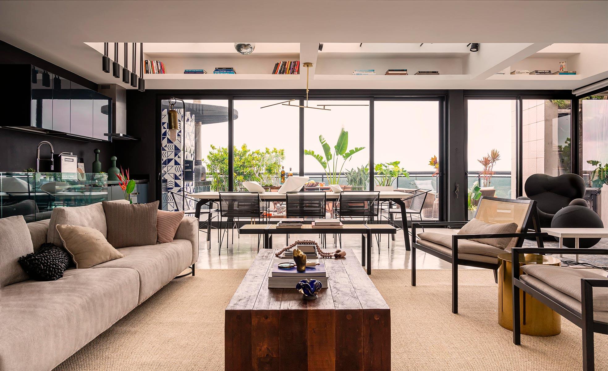 Living integrado com sala de jantar e terraço de Giovanna Antonelli | westwing.com.br